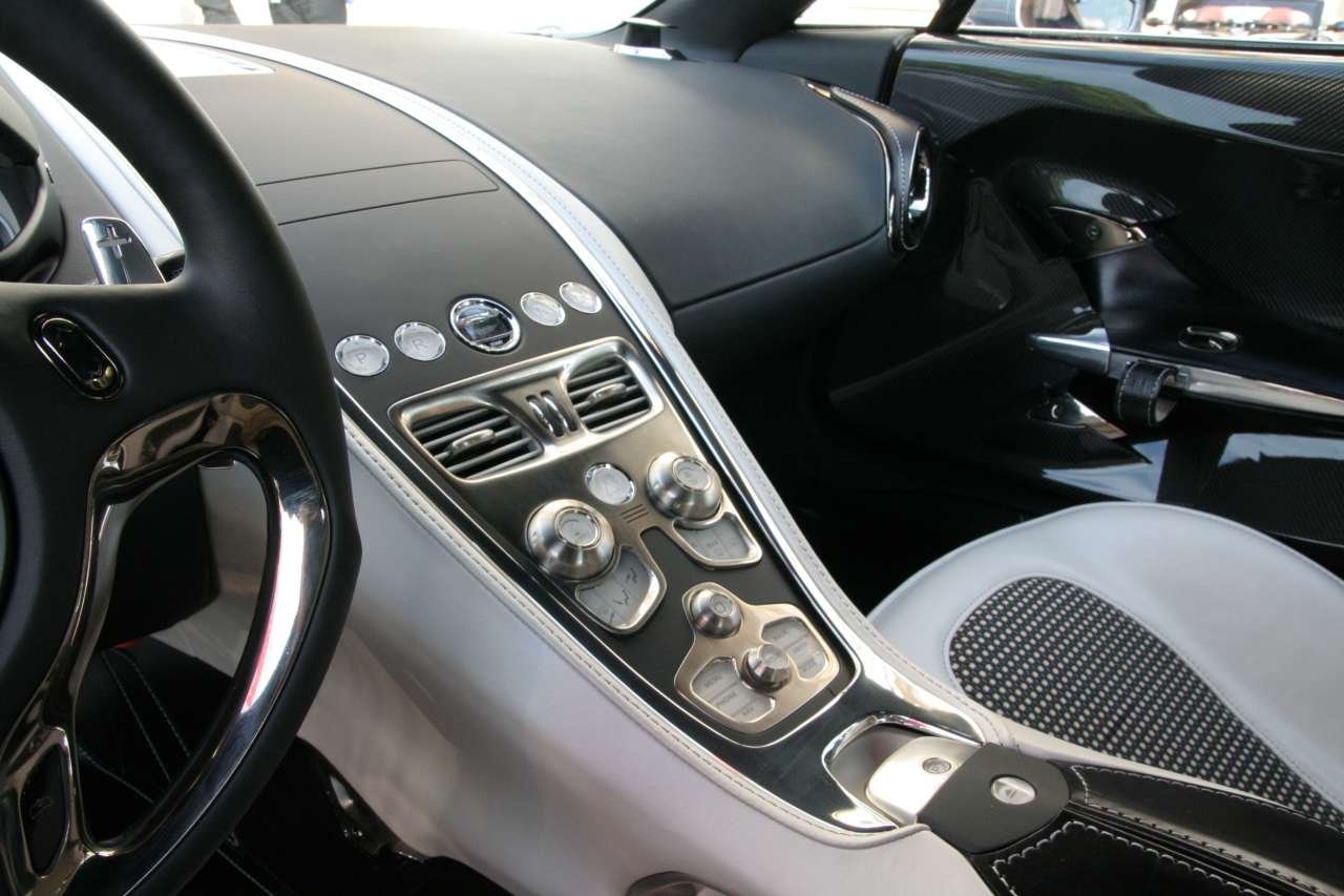 aston martin one 77 black interior. images source omniauto aston martin one 77 black interior