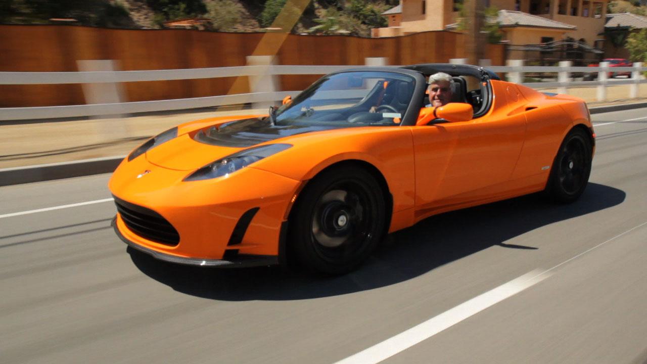 video jay leno drives 2010 tesla roadster 2 5. Black Bedroom Furniture Sets. Home Design Ideas