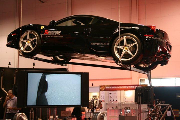 Akrapovic Exhaust System's 2010 SEMA Booth Featuring Hanging Ferrari 458 Italia