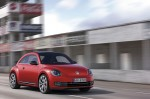 2012-Volkswagen-Beetle-in-red,-exterior-in-motion