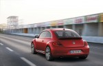 2012-Volkswagen-Beetle-in-red,-rear-exterior-in-motion