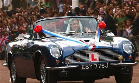 Prince William and Catherine Drive by in vintage Aston Martin DB6 Volante MK II