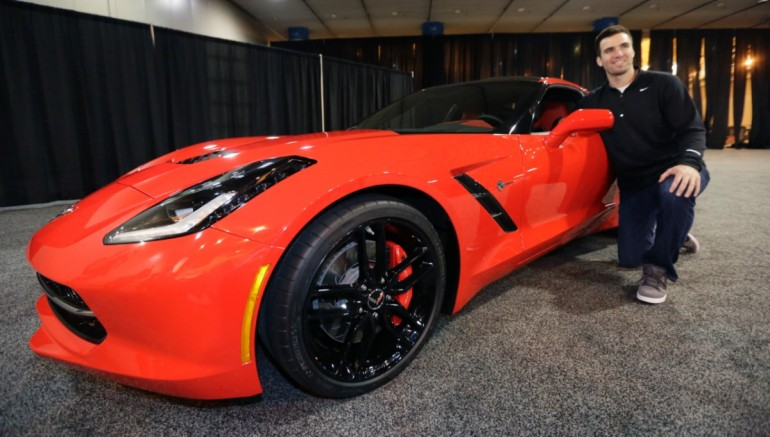 Joe Flacco poses with his new Chevrolet Corvette Stingray - image : AJ Mast for Chevrolet