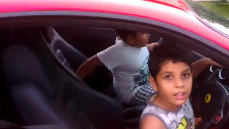 Kids Driving A Ferrari F430