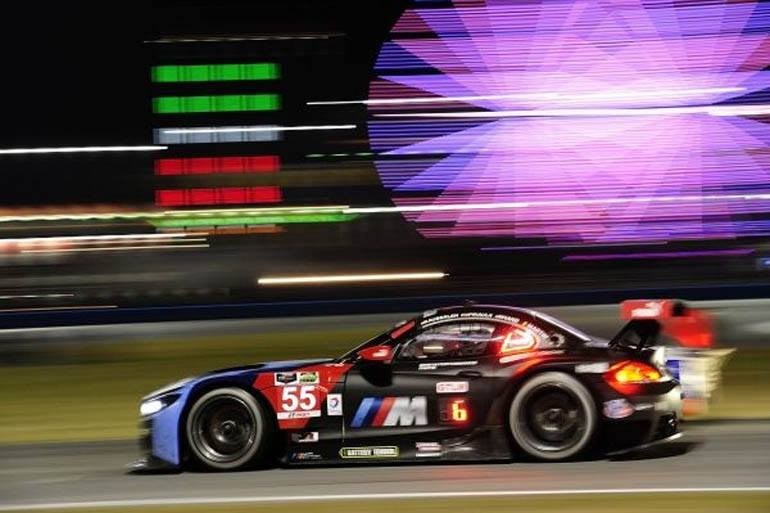 The No. 56 BMW Z4 GTLM runs through the night at the 2014 running of the Rolex 24 at Daytona.