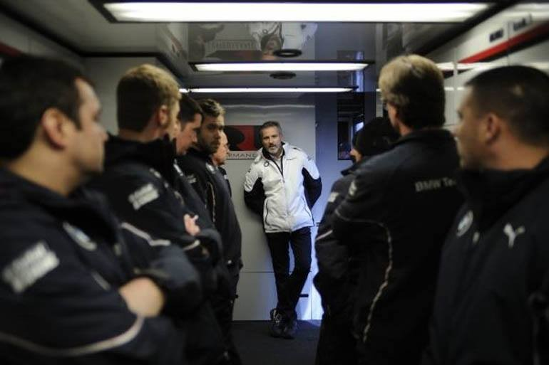 Jens Marquardt, BMW Motorsport Director, briefs the members of BMW Team RLL in the team transporter before the running of the 2014 Rolex 24 at Daytona. (