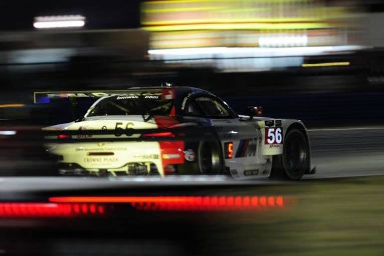 The No. 55 BMW Z4 GTLM runs through the night at the 2014 running of the Rolex 24 at Daytona.