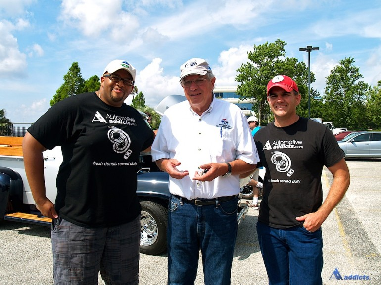 Malcolm Hogan (left) and Chris Brewer (far right) speak with Amelia Concours d'Elegance founder and president, Bill Warner at the May 2014 Automotive Addicts Cars & Coffee