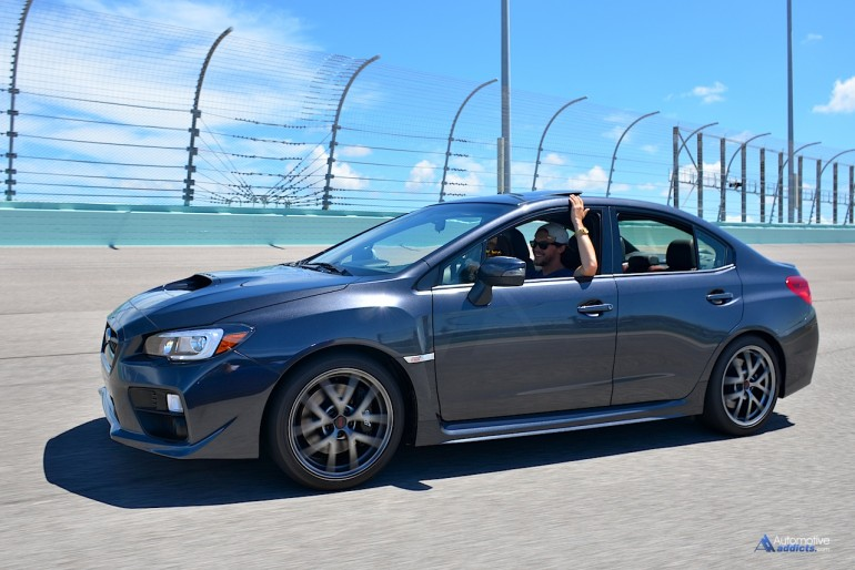 Alex Kinsey has a little fun with the 2016 Subaru WRX STI on a couple relaxed runs around the circuit. The STI is equally at home full out on that track as it is being used as a daily driver for a family of four.