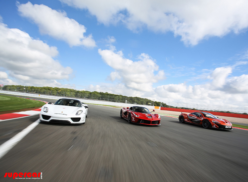 mclaren p1 laferrari porsche 918 duke it out on track to find out which is fastest video. Black Bedroom Furniture Sets. Home Design Ideas