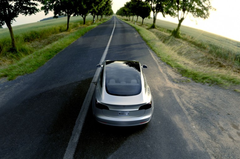 Tesla-Model-3-from-above-and-behind-with-open-road