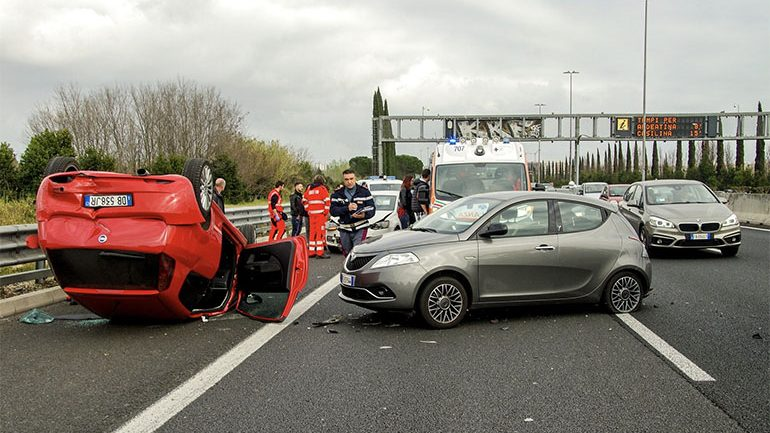 What would a person do at the scene of a car wreck?